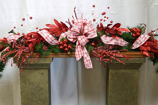 using a tree branch as an anchor for hanging christmas garlands - Christmas Garlands