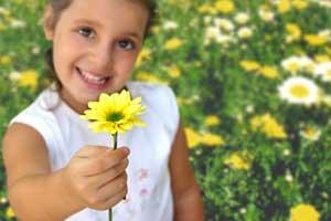 girl giving daisy