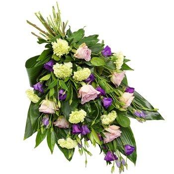 Purple hint funeral bouquet