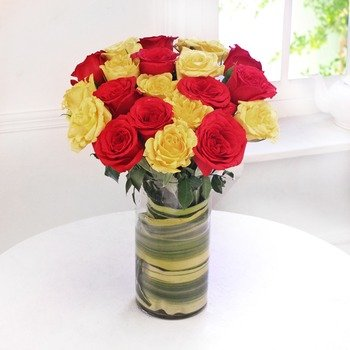 Mix of Yellow & Red Roses in a Glass Vase